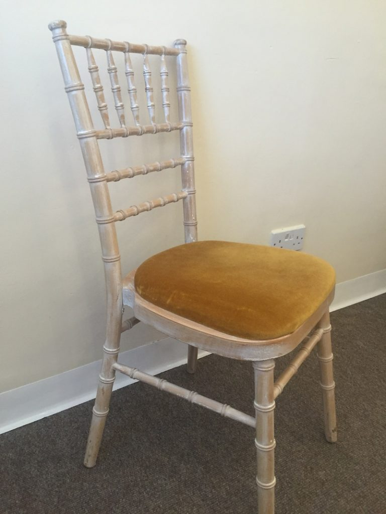 Home chair hire lime washed chivari chair with gold seat pad